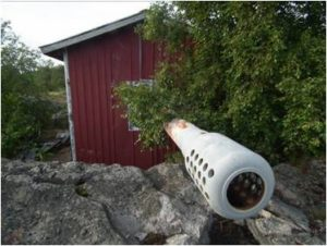 There's a pleasant walk around the island, featuring this surprising gun in a shed