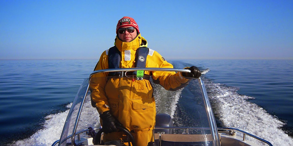 Olli Vuola navigating the Gulf of Finland in an open boat